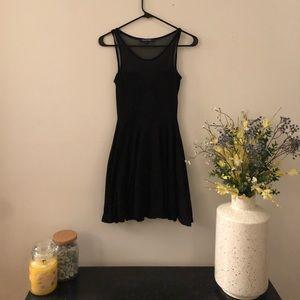Black mesh pleated dress.